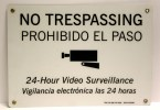 no trespassing, prohibido el paso, 24 hour video surveillance, vigilancia electroica las 24 horas
